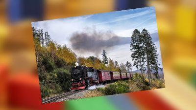 Bahn fährt im Gebirge